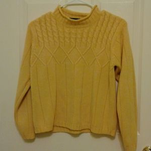 A lady's sweater in good condition
